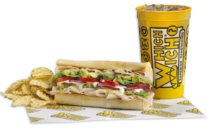 Turkey and avocado sandwich with which wich chips and drink